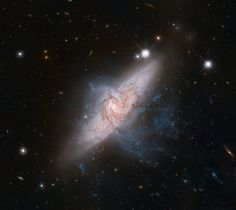 In an amazing chance photograph, the Hubble Space Telescope snapped a view of two galaxies lining up, one behind the other, as viewed from the space telescope's vantage point. The image offers a rare view of the overlapping galaxies, which are collectively known as NGC 3314, Hubble scientists said in a statement.