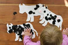 Black, white and pink felt cow decorating activity for cow-themed birthday. By Calm Cradle Photo & Design