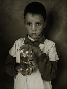 Albert WATSON :: Mostapha Elhanch, Boy with Jar, Marrakech, 1997