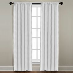 Add understated style to your home's windows with this elegant curtain panel pair. Made from 100-percent linen, these unlined pearl-colored drapes will look fabulous in your living or dining rooms, or any room where you want a touch of low-key style.