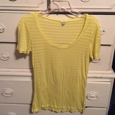 Bright yellow sheer Fossil t-shirt size xs Bundle 3 or more items and save an additional 15%.  Much more value to offset the shipping charges! Fossil Tops Tees - Short Sleeve