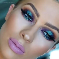 "Iridescent metallic makeup look. Reminds me of the "" futuristic "" early 2000's :]. Matte lavender purple / pink lipstick"