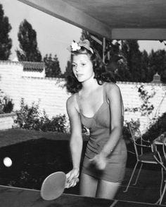 Rita Hayworth playing ping pong