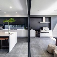 Renovation ideas: 5 ways to make your home cohesive - The Interiors Addict Island bench kitchen to the alfresco, grey granite tiles, White ceiling dark grey wall Indoor Outdoor Kitchen, Outdoor Kitchen Design, Outdoor Rooms, Kitchen Outdoor Extension, Outdoor Kitchens, Patio Kitchen, Outdoor Tiles, Kitchen Tips, Kitchen Island