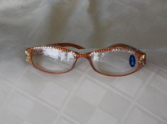 Check out 1.50 Reading Glasses Hand Designed with Swarovski crystals. Amber frames with Diamond Leaf Crystals, Shimmering Volcanic Crystals and Clear on jamaartbeads