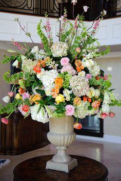 Altar flowers without the orange flowers, white hydrangeas, bells of Ireland, something very beautiful!!!