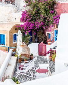 Terrace of a colorful house with flowers on the island of Santorini, Greece #santorini #greece #house #flowers #terrace #europe #travel