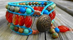 SOLD - Turquoise and Carnelian 3 row single wrap leather bracelet with charms.    See it on GemOnAWire.Artfire.com.      $57