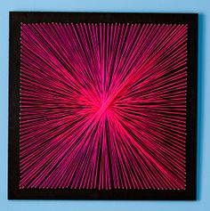 """String Art - 1/2"""" x 2' x 4' birch plywood cut into 2' x 2' squares painted with valspar black, 16 x 1"""" bright steel wire nails, and 2 pink nylon mason lines (material found at Lowes)"""