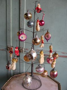 Wire Charlie Brown Christmas tree with vintage ornaments...Love it!