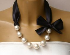 Items similar to Carrie Necklace - Carrie Bradshaw Inspired Pearl Necklace In Black Color Satin Ribbons. Perfect for Bride, Wedding, Bridesmaids And Formal on Etsy Pearl Jewelry, Beaded Jewelry, Jewelery, Handmade Jewelry, Jewelry Necklaces, Pearl Bracelets, Pearl Rings, Pearl Necklaces, Geek Jewelry