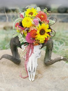 Pretty boho wedding decor - skull adorned with gorgeous spring blooms.