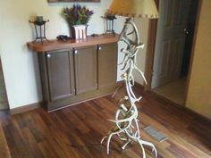 My co-worker made this lamp out of deer sheds he has found. I think this would go very well in a rustic home with an antler chandelier.