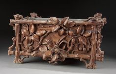 A SWISS CARVED BLACK FOREST FERNERY late 19th century.