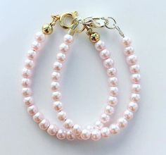 A personal favorite from my Etsy shop https://www.etsy.com/listing/249013095/pearl-bracelet-pink-pearls-baby-bracelet