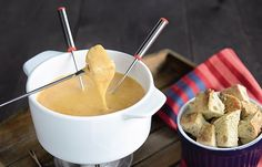 VEGAN CHEESE FONDUE For 4 people Preparation time: 15 minutes 100g tapioca [tapioca flour or starch is fine] 500 ml of plain soy milk 500ml dry white wine 1/2tsp smoked paprika 1tsp garlic powder 30 g of malted yeast 1/8 of a nutmeg, finely grated 2 cloves, ground or finely powdered 100 ml of canola/rapeseed oil 1 garlic clove 1 dash of kirch (a strong, clear spirit) 1tsp unrefined fine salt Black pepper 400g sandwich bread