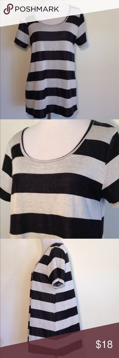 LuLaRoe Classic Tee M Black Grey Stripes LuLaRoe Classic Tee size Medium. Large black and gray stripes. In good used condition - some light piling. LuLaRoe Tops