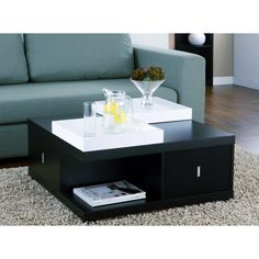 Refined, understated style highlights the look of the Mareines coffee table with serving trays. This furniture features wood construction and rich colors.