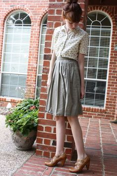 Love the blouse. Love the skirt. Love the shoes. So Vintage!