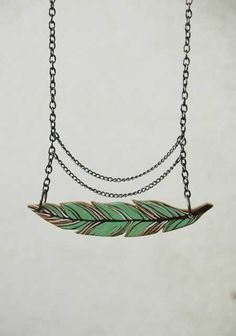 Mint Green Wooden Feather  Necklace. $20.00, via Etsy.