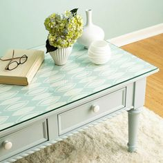 Wallpaper can dress up a table. Pick a graphic pattern that looks nice from any angle. Avoid a curved tabletop to ease the trimming. Paint the table a coordinating color; let dry. Cut the paper to size and lay on top. Finish with a custom-cut glass top to protect the paper.