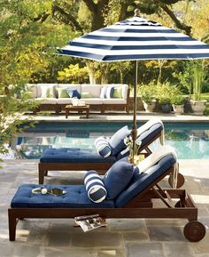 ...cabana stripes! navy and white poolside lounges resort style