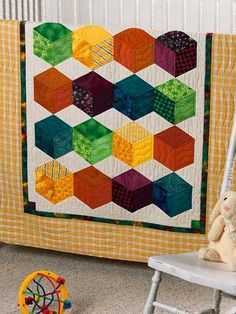Crayon Box Cubes Crib Quilt-Try English paper piecing by machine to stitch this colorful crib quilt. Size: x Skill Level: Beginner Designed by Jodi Warner Free Baby Quilt Patterns, Baby Quilt Tutorials, Quilt Block Patterns, Quilting Tutorials, Quilting Projects, Hexagon Quilting, Sewing Projects, Baby Crayons, Cubes