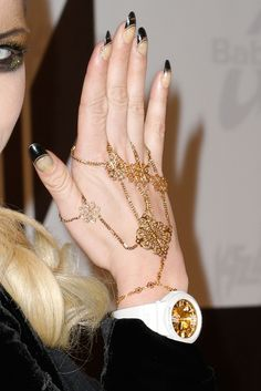 Kesha Photos Photos - Singer Ke$ha (nail and jewelry detail) attends a press conference launching her 2nd watch collaboration with Baby-G at SLS Hotel on October 29, 2012 in Beverly Hills, California. - Ke$ha Press Conference Launching Her 2nd Watch Collaboration With Baby-G