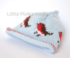 A little Christmas baby beanie knitting pattern with festive little Christmas Robin Redbreats The pattern has instructions to knit hats in the