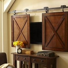 Rolling Cabinet Media Solution - This is another clever idea to hide your TV above the mantel. I love its barn door look and think it would look amazing on a rustic fireplace.