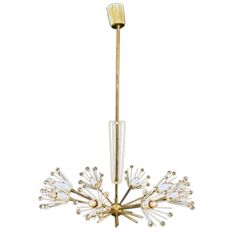 """Elegant Eurpoean Chandelier with Crystal Embellishments England  1960's  A wonderful and elegant chandelier, similiar to the popular sputnik chandelier but with more elegance. The sockets are surrounded by wire cages finished with crystal embellishments. 24"""" diameter.  There are two available. Lost City Arts U12052580481655 $1,800 DR/K charming chic fun but maybe too modern for you"""