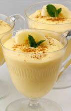 Banana Mousse  2 Tbsp. low-fat milk  4 tsp. brown sugar  1 tsp. vanilla extract  1 medium banana, quartered  1 cup plain, low-fat yogurt  4 slices banana (1/4 inch each)