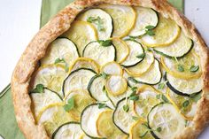 Zucchini, Squash and Ricotta Galette. July, 2014 update - made this for dinner tonight. Used white whole wheat flour because that's what I had on hand. Turned out beautifully and really delicious. Recipe is very forgiving, so you can do whatever you'd like with the amounts of veggies and cheese. Already planning to make for my friends.