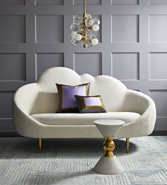 The Ether Settee has a simple genesis story: JA wanted to create a settee that looks and feels like heaven. The chic cloud silhouette and lozenge-like form are enveloping and inviting, while gleaming brass stiletto legs project posh presence. Ethereal yet edgy, it's upholstered in glistening Bergamo Snow upholstery for maximum other-worldly elegance. Low and loungey, and comfortable.