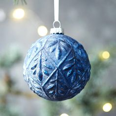 Best Coastal Ornaments: Indigo blue is everywhere, and we're loving it in this ornament featuring a raised pattern. | CoastalLiving.com