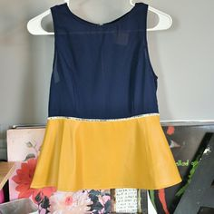 Sleeveless top Sleeveless top with faux leather peplum. Bought at a boutique. Tampa Boutique Tops Blouses