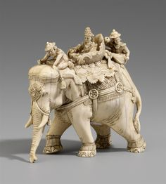 A Thai ivory figure of a caparisoned elephant. Early 20th century