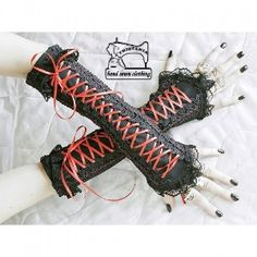 Goth:  Gothic gloves in corset style.  Made of elastic fabric in black and lace.  Embroidery on both sides.