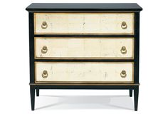 With cream-colored églomisé glass accents, hinged brass hardware, and a delicate golden trim, this handcrafted three-drawer dresser evokes an Old World feel. Carved of maple solids and topped with...