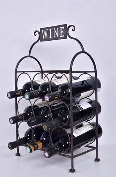 "This Metal Wine Stand holds 9 bottles and makes a wonderful display on the table, counter top, or bar. Made of sturdy iron.  Features •Modern wine bottle organizer •Sturdy metal construction •Makes an attractive display •Perfect storage place for up to 9 bottles of wine •Dimensions: 13"" L x 6 3/4"" W x 22"" H"