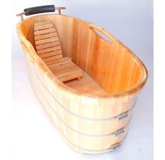 Turn any bathroom into an eye catching spectacular with a high end wooden tub. The perfect addition to any log style cabin or winter home. Nothing feels better than crawling into a tub made of wood and filled with steaming hot water. Just lay back a Wooden Bathtub, Wood Bath, Wooden Bathroom, Wood Tub, Small Bathtub, Outdoor Bathtub, Soaking Bathtubs, Saunas, Winter House