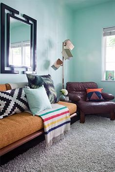 I really like the black chinoiserie mirror with the minty or aqua walls & ceiling. NOt feeling the carpet with the furniture though. ~ 5 budget-friendly tips to help you make your space shine! Interior Design Inspiration, Home Decor Inspiration, Design Ideas, Sofas, Couch, Dream Decor, Looks Cool, Better Homes, Apartment Living