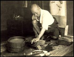 vintage swordsmith working on curved blade