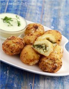 """Who says a person cannot feast when fasting! faral means """"fast"""" and these pattice are designed specifically for those who are fasting. The coating of arrowroat adds a unique dimension to this otherwise common dish. Served with sweetened curds, to complete the mast experience!"""