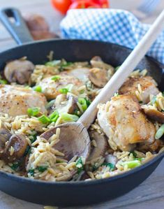 Chicken and Orzo in a pan with a wooden serving spoon