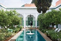 The swimming pool at this 18th-century Marrakech riad features a 19th-century Indian fountain.