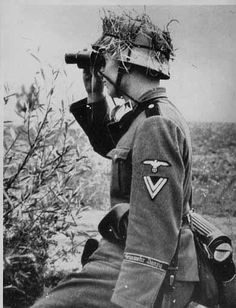 Waffen-SS Corporal. Date and location unknown.