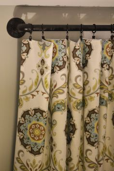 DIY industrial pipe curtain rods - great for a large window! {West Elm knock-off} I luv the curtain print! Industrial Curtain Rod, Industrial Pipe, Pipe Curtain Rods, Knock Off Decor, Window Rods, Huge Windows, Window Coverings, Window Treatments, Up House
