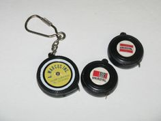 VINTAGE ADVERTISING POCKET KEYCHAIN TIRE TAPE MEASURES UNIROYAL ~ A. MARCUS INC.