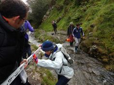We tramped down through a stream like this taking measurements of the steepness of its course.